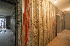 Working process of install of frames for plasterboard and corrugated pipe with electrical cables in an apartment is royalty free stock photos