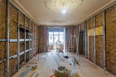 Working process of installing metal frames for plasterboard drywall for making gypsum walls. And tools in apartment is under construction, remodeling Stock Photo