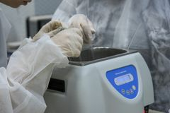 Working process in nanotechnology laboratory of cosmetic production. Mixing components. Close-up hands of technologist making nano creams. ingredients and stock photo