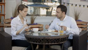 Working on project together. Business partners having a conversation at a cafe stock footage