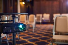 Working projector at the conference hall. Working projector at the empty conference hall Stock Photo