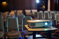 Working projector at the conference hall. Working projector at the empty conference hall Stock Photography