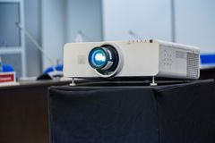 Working projector at the conference. Hall stock images