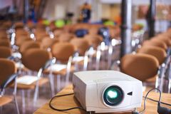 Working projector at the empty conference hall stock images