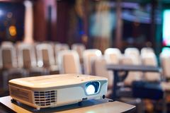Working projector at the conference hall. Working projector at the empty conference hall Stock Image