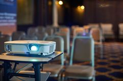 Working projector at the conference hall. Working projector at the empty conference hall Royalty Free Stock Photos
