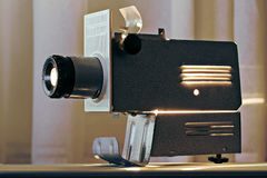 Working projector on table top radiating heat Royalty Free Stock Photo
