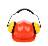Working protective headphones on hard hat. Royalty Free Stock Photos