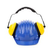 Working protective headphones on hard hat Stock Image