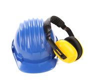 Working protective headphones on hard hat Stock Photography