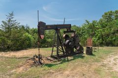 Working Pump Jack Pumping Crude Oil At Oil Drilling Site In Rura Stock Image