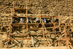Working on the Pyramids. This picture was taken in December 2007. It shows some people standing on wooden scaffolding while working on repairing the Pyramid of Stock Photography
