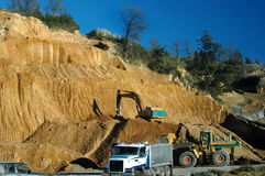 Working Quarry. Loaders loading spoil into truck Stock Photos