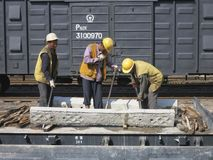 Working on the Railroad. Three people are working on a railroad in China. China is building rail line faster than any country on earth Stock Photography