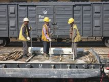 Working on the Railroad. Three people are working on a railroad in China. China is building rail line faster than any country on earth Royalty Free Stock Photo