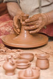 Working with raw clay. Royalty Free Stock Photography