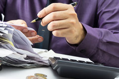 Working with receipts. Closeup businessman working with receipts Royalty Free Stock Photos