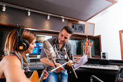 Working in the recording studio. Hispanic producer and young singer working in the recording studio Stock Images