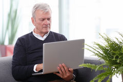 Working retired man Stock Photos