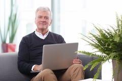 Working retired man Stock Photo