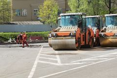 Working rink ready for laying asphalt on the road in the city. Repair of roads stock photos