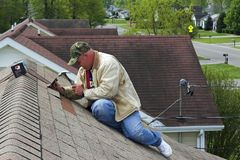 Working on roof Royalty Free Stock Images