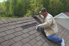 Working on roof royalty free stock image