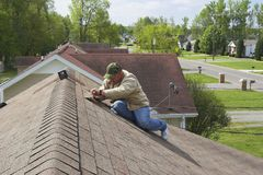 Working on roof 3 Stock Photos