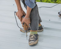 Working on the roof Royalty Free Stock Images