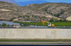 Working On The Runway At Alicante Airport Stock Photo