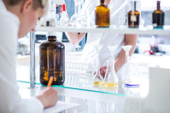 Working in science lab Royalty Free Stock Photos
