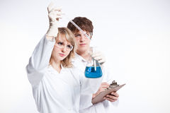 Working scientists. A shot of a male and female caucasian scientists stock photography