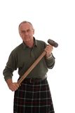 Working Scotsman with a large hammer Royalty Free Stock Images