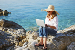 Working by the sea Royalty Free Stock Photography