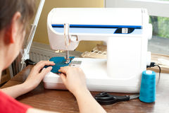 Working seamstress Stock Photo