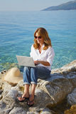 Working at the seaside Stock Image