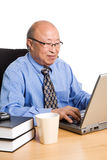 Working senior asian businessman Royalty Free Stock Photo