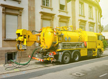 Working Sewage truck working in urban city environment Stock Image