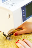 Working on the sewing machine Stock Photo