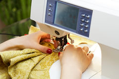 Working on the sewing machine Stock Photos