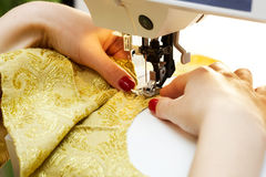 Working on the sewing machine Royalty Free Stock Image