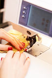 Working on the sewing machine Royalty Free Stock Photos