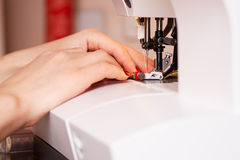 Working on the sewing machine Stock Photography