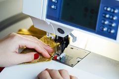 Working on the sewing machine Stock Images