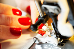 Working on the sewing machine Royalty Free Stock Images