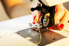 Working on the sewing machine Royalty Free Stock Photo