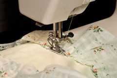 Working sewing machine. Sewing ruffles on the hand-sewing machine Royalty Free Stock Photography