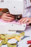 Working on sewing machine. Stock Photo