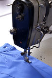 Working on sewing machine. Royalty Free Stock Photos