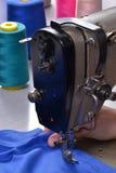 Working on sewing machine. Stock Photo